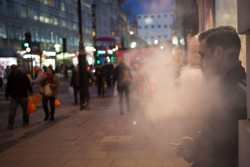The vapour from vaping emerges onto a street
