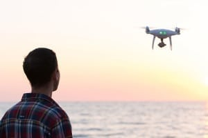 A person looking at a drone